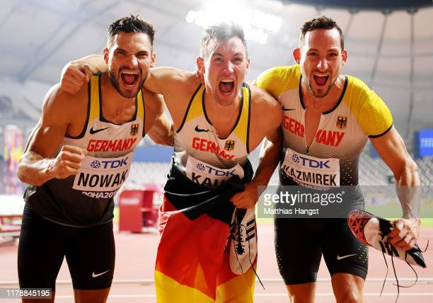 Niklas Kaul, gold, of Germany celebrates with Tim Nowak of Germany and Kai Kazmirek of Germany after the Men's Decathlon 1500 Metres during day seven...
