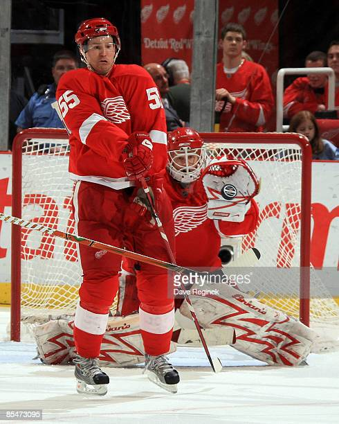 Niklas Kronwall and goalie Chris Osgood of the Detroit Red Wings get ready to block a shot during a NHL game against the Philadelphia Flyers on March...
