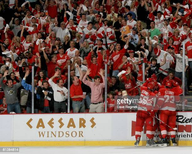 Niklas Kronwall Brad Stuart and other teamates of the Detroit Red Wings celebrate a goal as the fans go crazy during game two of the 2008 NHL Stanley...