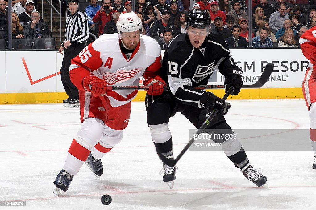 Niklas Kronwall #55 of the Detroit Red Wings battles for the puck against Tyler Tofolli #73 of the Los Angeles Kings at Staples Center on January 11, 2014 in Los Angeles, California.