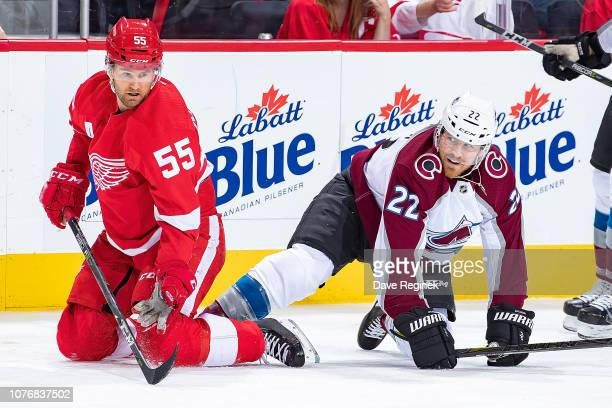Niklas Kronwall of the Detroit Red Wings body checks to the ice Colin Wilson of the Colorado Avalanche during an NHL game at Little Caesars Arena on...