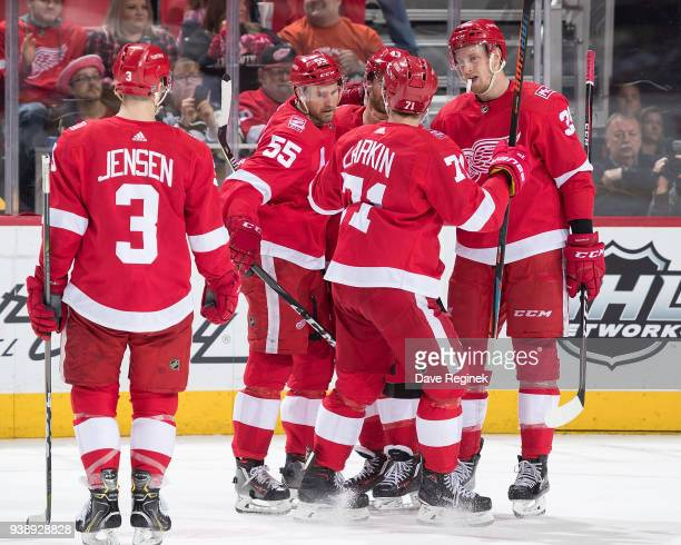 Niklas Kronwall of the Detroit Red Wings celebrates his 400th career NHL point and 1st period goal with teammates Darren Helm Dylan Larkin Nick...