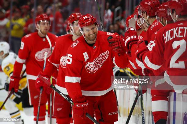 Niklas Kronwall of the Detroit Red Wings celebrates his first period goal with teammates while playing the Pittsburgh Penguins at Little Caesars...
