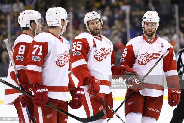Niklas Kronwall of the Detroit Red Wings celebrates with Justin Abdelkader Dylan Larkin and Mike Green after scoring against the Boston Bruins during...