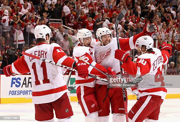 Niklas Kronwall of the Detroit Red Wings celebrates with teammates Daniel Cleary Nicklas Lidstrom and Henrik Zetterberg after Kronwall scored the...