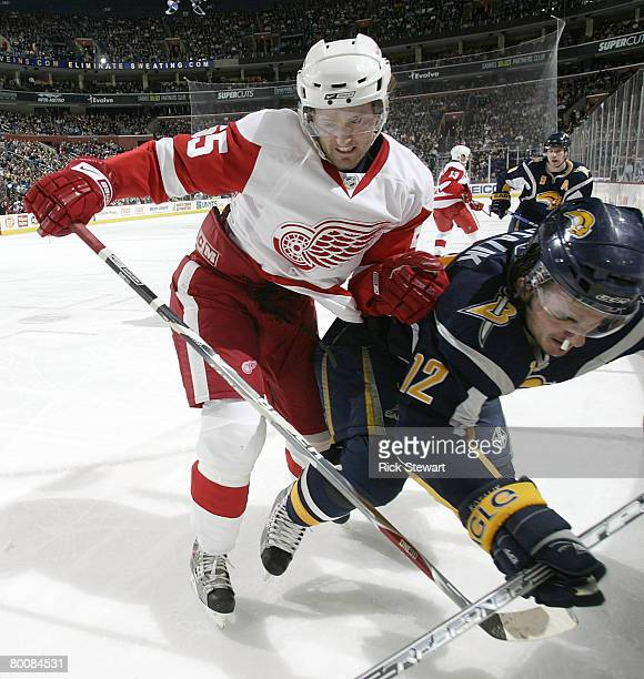 Niklas Kronwall of the Detroit Red Wings checks Ales Kotalik of the Buffalo Sabres on March 2, 2008 at HSBC Arena in Buffalo, New York.