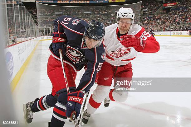 Niklas Kronwall of the Detroit Red Wings defends against Andrew Murray of the Columbus Blue Jackets on March 16, 2008 at Nationwide Arena in...