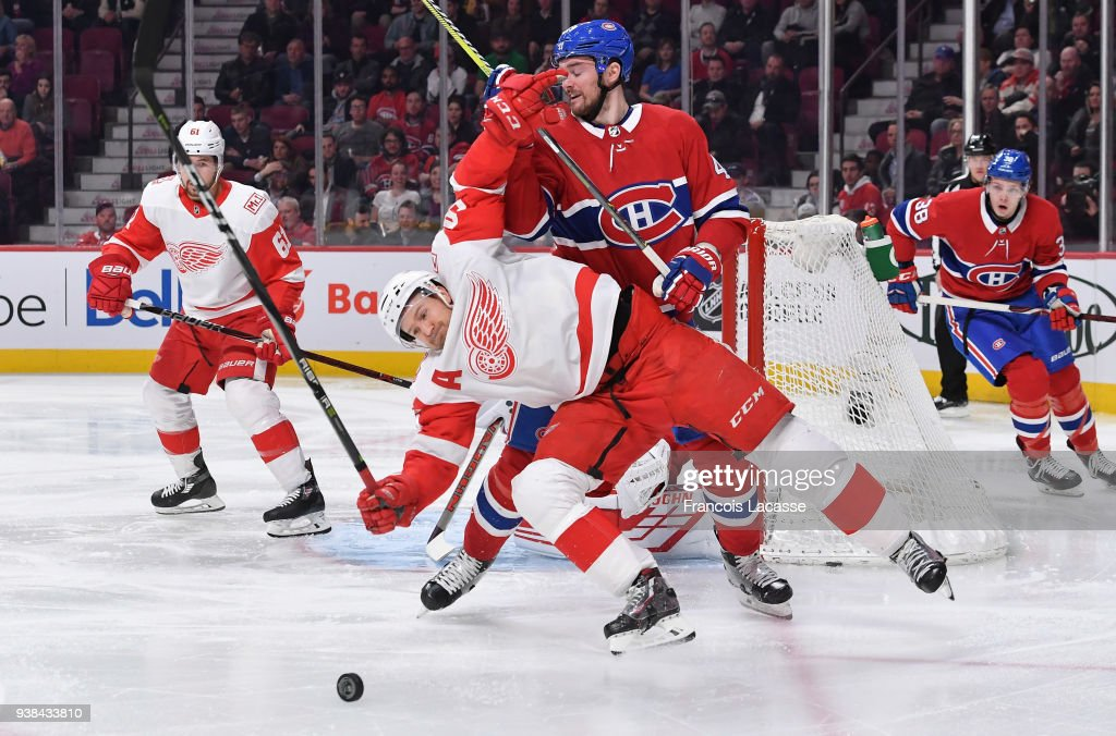 Niklas Kronwall #55 of the Detroit Red Wings defends against Logan Shaw #49 of the Montreal Canadiens in the NHL game at the Bell Centre on March 26, 2018 in Montreal, Quebec, Canada.