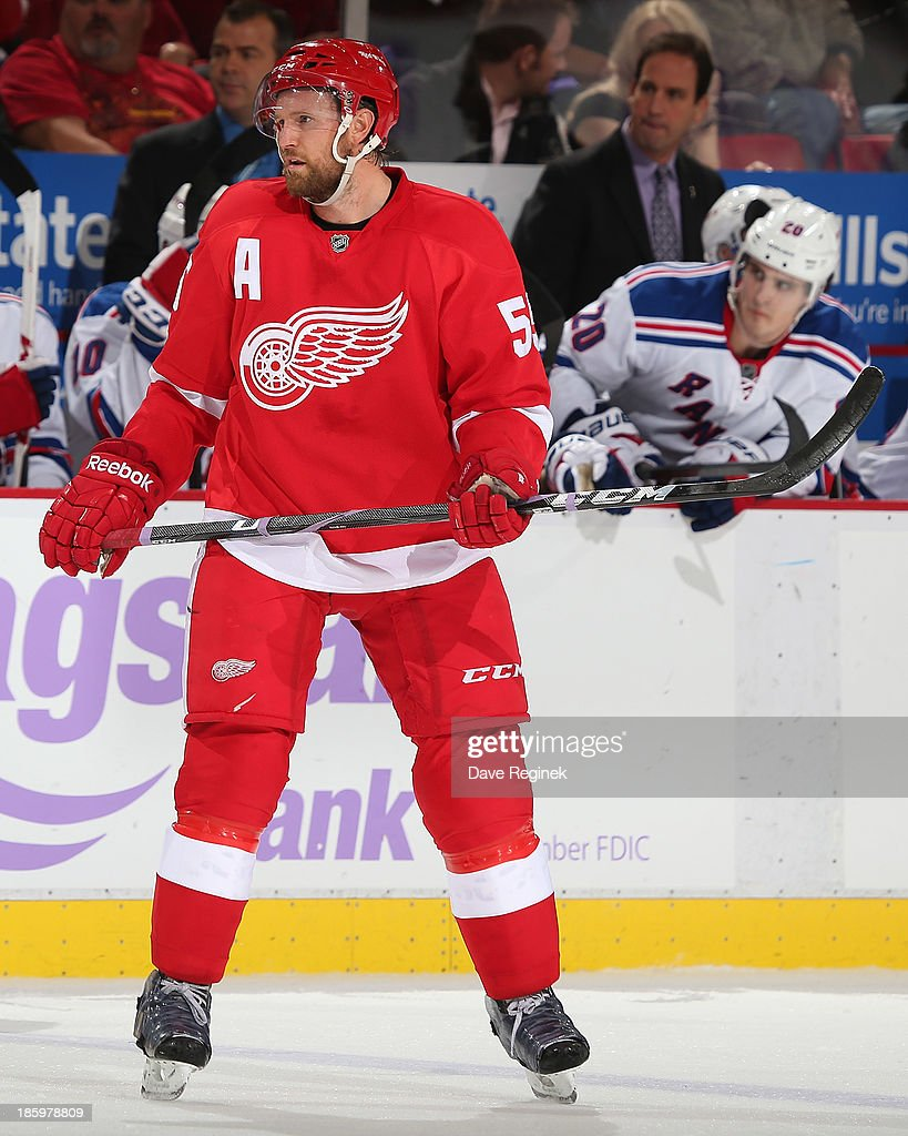 Niklas Kronwall #55 of the Detroit Red Wings follows the play against the New York Rangers during an NHL game at Joe Louis Arena on October 26, 2013 in Detroit, Michigan. The Rangers win in O