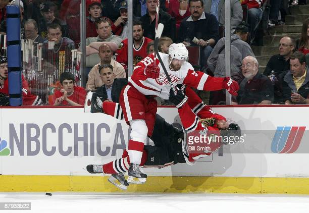 Niklas Kronwall of the Detroit Red Wings hammers into Martin Havlat of the Chicago Blackhawks which knocks him cold during Game Three of the Western...