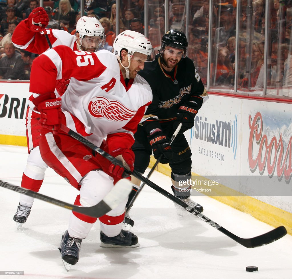 Niklas Kronwall #55 of the Detroit Red Wings handles the puck against Kyle Palmieri #51 of the Anaheim Ducks in Game Seven of the Western Conference Quarterfinals during the 2013 NHL Stanley Cup Playoffs at Honda Center on May 12, 2013 in Anaheim, California.
