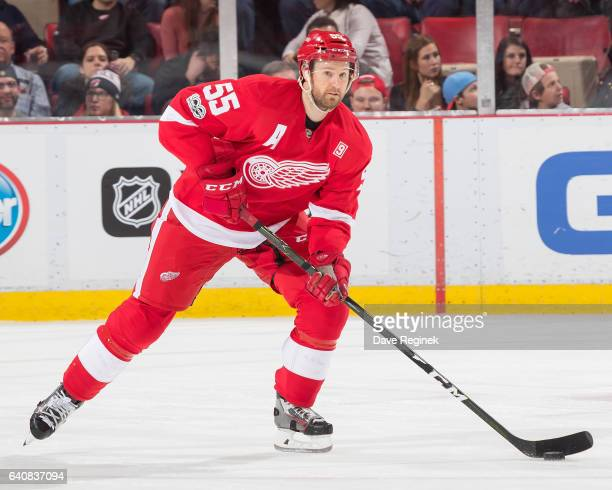 Niklas Kronwall of the Detroit Red Wings skates up ice with the puck against the New Jersey Devils during an NHL game at Joe Louis Arena on January...