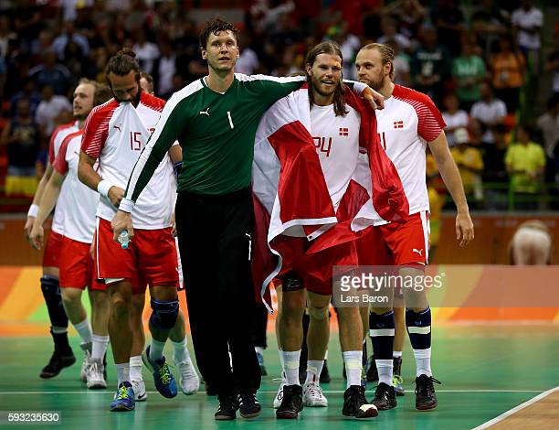 Niklas Landin Jacobsen and Mikkel Hansen of Denmark react after defeating France 2826 to win the gold medal in Men's Handball on Day 16 of the Rio...