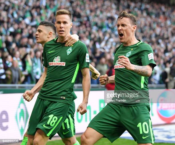 Niklas Moisander celebrates coring his goal with Max Kruse of Bremen during the Bundesliga match between SV Werder Bremen and RB Leipzig at...