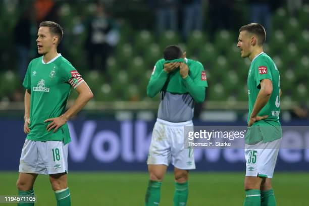 Niklas Moisander Milot Rashicaand Maximilian Eggestein of Bremen look dejected after losing the Bundesliga match between SV Werder Bremen and 1 FSV...