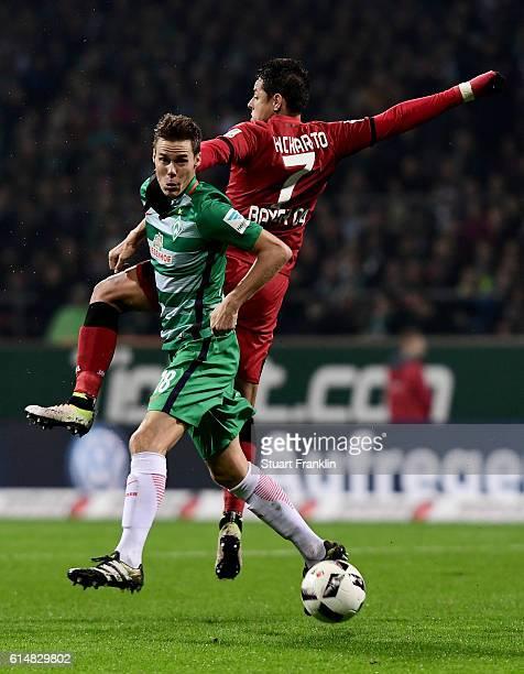 Niklas Moisander of Bremen and Chicharito of Leverkusen battle for the ball during the Bundesliga match between Werder Bremen and Bayer 04 Leverkusen...