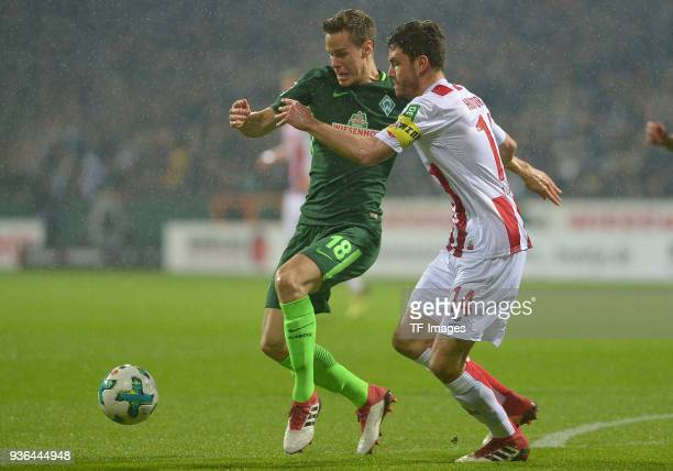 Niklas Moisander of Bremen and Jonas Hector of Koeln battle for the ball during the Bundesliga match between SV Werder Bremen and 1 FC Koeln at...