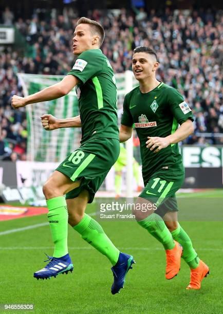 Niklas Moisander of Bremen celebrate with team mate Milot Rashica after he scores the opening goal during the Bundesliga match between SV Werder...