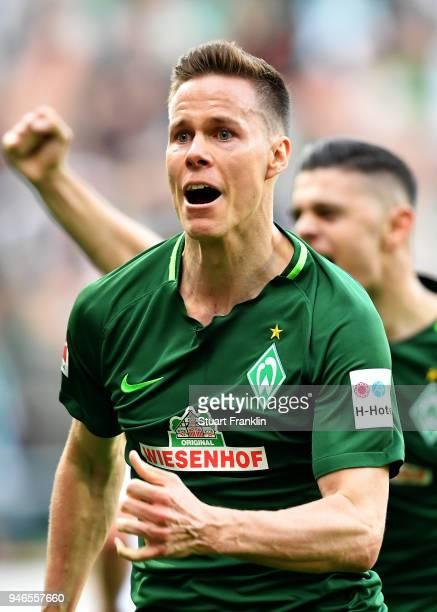 Niklas Moisander of Bremen celebrates after he scores the opening goal during the Bundesliga match between SV Werder Bremen and RB Leipzig at...