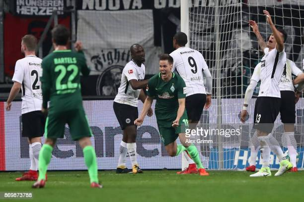 Niklas Moisander of Bremen celebrates his team's first goal during the Bundesliga match between Eintracht Frankfurt and SV Werder Bremen at...