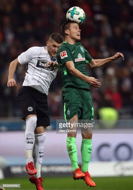 Niklas Moisander of Bremen jumps for a header with Ante Rebic of Frankfurt during the Bundesliga match between Eintracht Frankfurt and SV Werder...