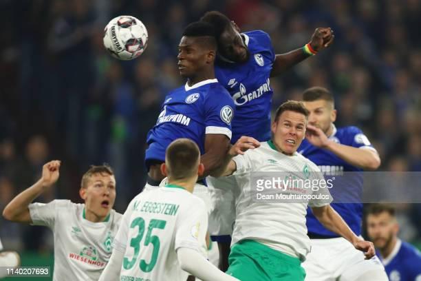 Niklas Moisander of Bremen jumps for a header with Salif Sane and Breel Embolo of Schalke during the DFB Cup quarterfinal match between FC Schalke 04...