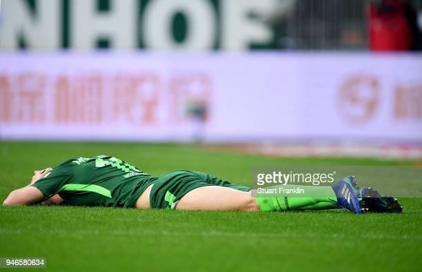Niklas Moisander of Bremen lies on th pitch during the Bundesliga match between SV Werder Bremen and RB Leipzig at Weserstadion on April 15 2018 in...