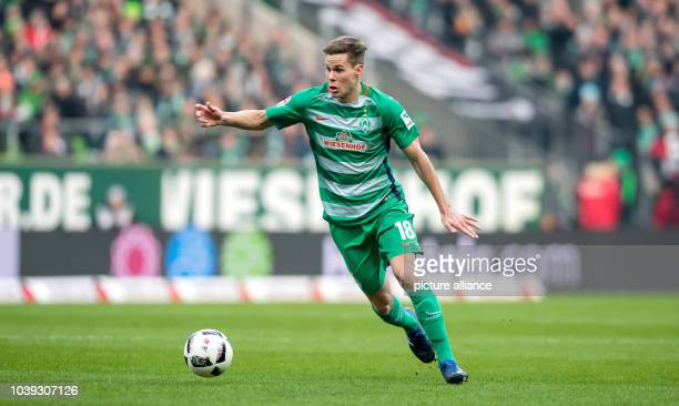 Niklas Moisander of Bremen plays the ball during the German Bundesliga soccer match between SV Werder Bremen and Borussia Moenchengladbach at the...