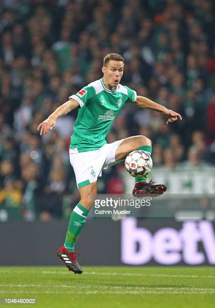 Niklas Moisander of Bremen runs with the ball during the Bundesliga match between SV Werder Bremen and VfL Wolfsburg at Weserstadion on October 5...