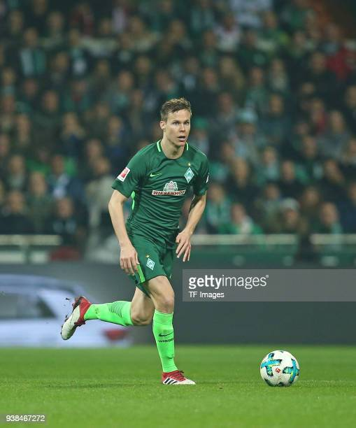 Niklas Moisander of Werder Bremen battle for the ball during the Bundesliga match between SV Werder Bremen and 1 FC Koeln at Weserstadion on March 12...
