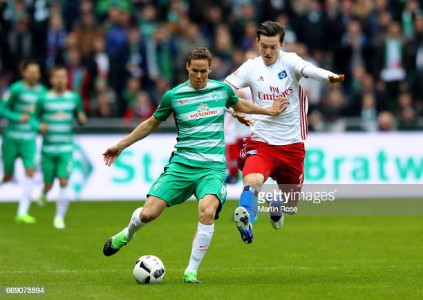 Niklas Moisaner of Bremen and Michael Gregoritsch of Hamburg battle for the ball during the Bundesliga match between Werder Bremen and Hamburger SV...
