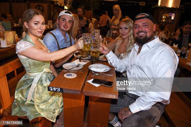 Niklas Nik Schroeder Jessica Neufeld Sonny Loops and Marcel Scorpion attend the Angermaier Trachtennacht at Hofbraeu Wirtshaus on August 29 2019 in...