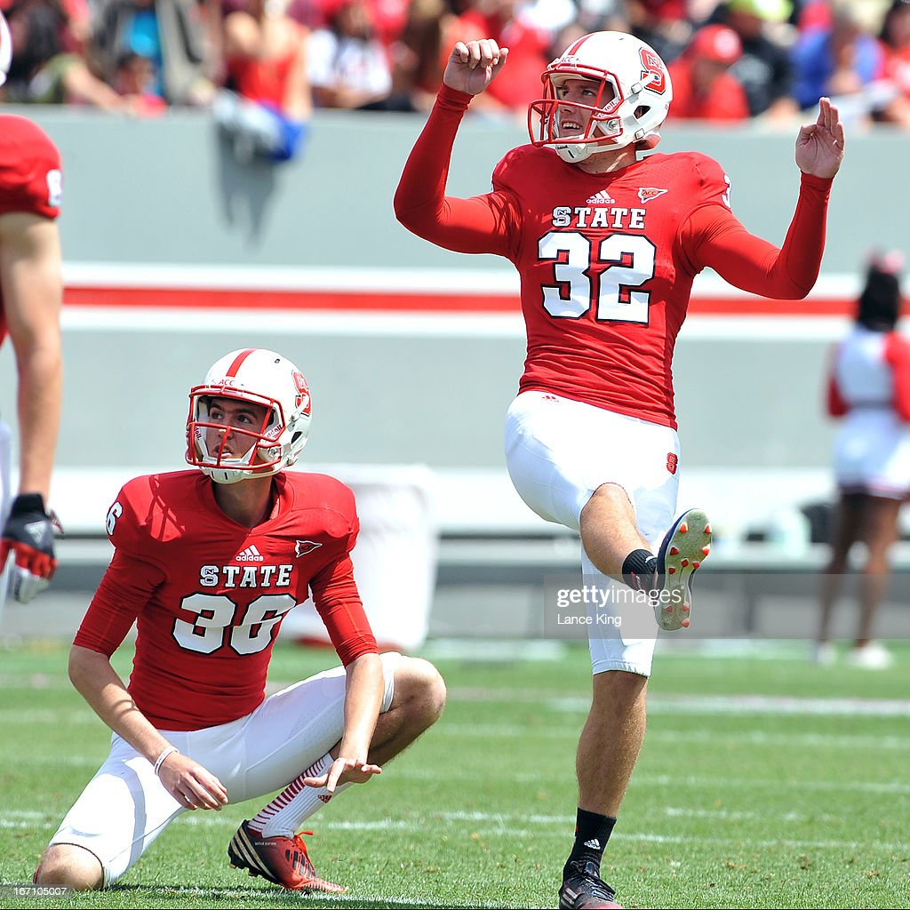 Niklas Sade #32 and Wil Baumann #36 of the North Carolina State Wolfpack look on during a field goal attempt during the Kay Yow Spring Football Game at Carter-Finley Stadium on April 20, 2013 in Raleigh, North Carolina.