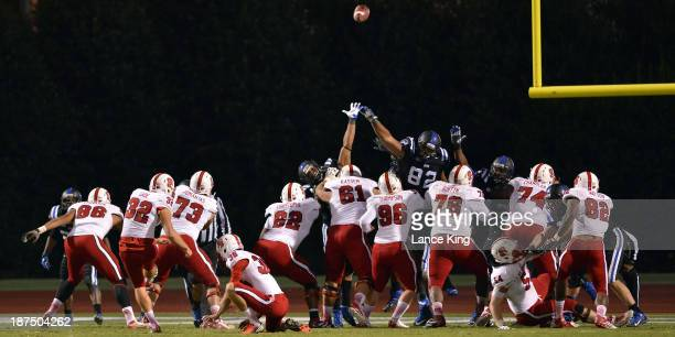 Niklas Sade of the North Carolina State Wolfpack kicks for an extra point against the Duke Blue Devils at Wallace Wade Stadium on November 9 2013 in...