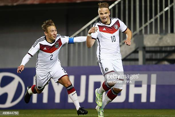 Niklas Schmidt of Germany celebrates his team's fourth goal with team mate Felix Passlack during the FIFA U17 World Cup Chile 2015 Group C match...