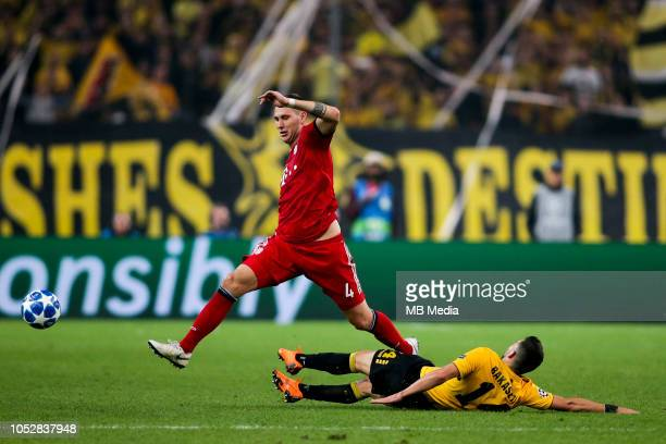 Niklas Süle of Bayern in action against Tasos Bakasetas of AEK during the Group E match of the UEFA Champions League between AEK Athens and FC Bayern...