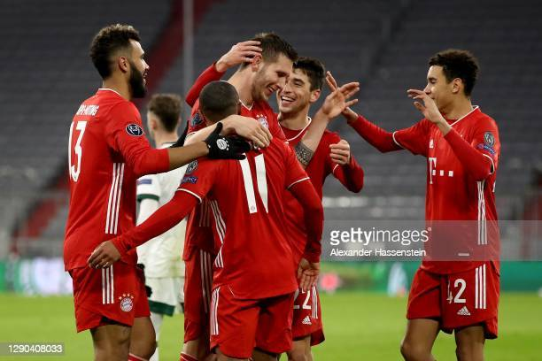 Niklas Süle of FC Bayern München celebrates scoring the opening goal with his team mates during the UEFA Champions League Group A stage match between...