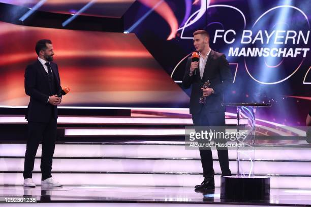 """Niklas Süle of FC Bayern München receives with team manager Hasan Salihamidzic the """"Team of the Year"""" award during the """"Sportler des Jahres"""" Gala at..."""