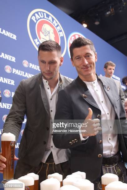 Niklas Süle of FC Bayern Muenchen attends with his team mate Robert Lewandowski the FC Bayern Muenchen and Paulaner photo session at Nockherberg on...