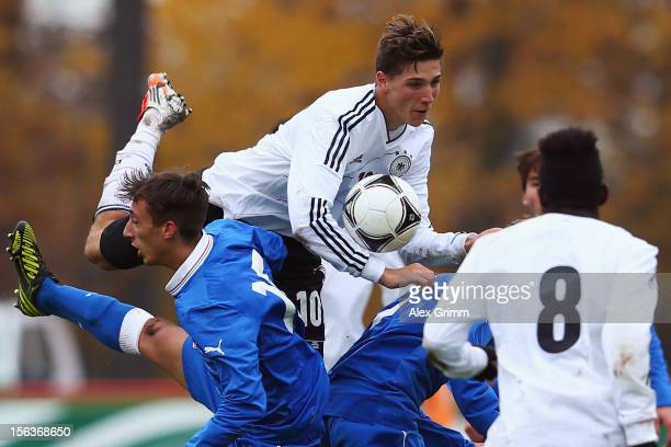 Niklas Stark of Germany is challenged by Alberto Rosa Gastaldo of Italy during the U18 international friendly match between Germany and Italy at...