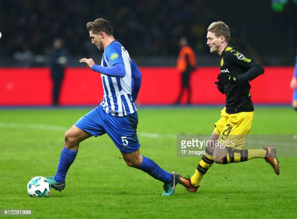 Niklas Stark of Hertha and Andre Schuerrle of Dortmund battle for the ball during the Bundesliga match between Hertha BSC and Borussia Dortmund at...