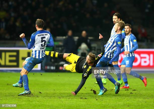 Niklas Stark of Hertha Andrey Yarmolenko of Dortmund Fabian Lustenberger of Hertha Marvin Plattenhardt of Hertha and Mathew Leckie of Hertha battle...