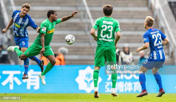 Niklas Stark of Hertha BSC jumps for a header with Alassane Plea of Borussia Moenchengladbach during the Bundesliga match between Hertha BSC and...