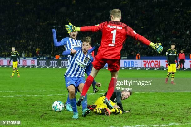 Niklas Stark of Hertha Goalkeeper Thomas Kraft of Hertha and Andrey Yarmolenko of Dortmund battle for the ball during the Bundesliga match between...
