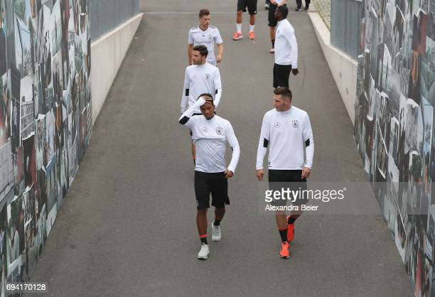 Niklas Suele and Benjamin Henrichs of the German national soccer team arrive for a training session on June 9 2017 in Herzogenaurach Germany Germany...