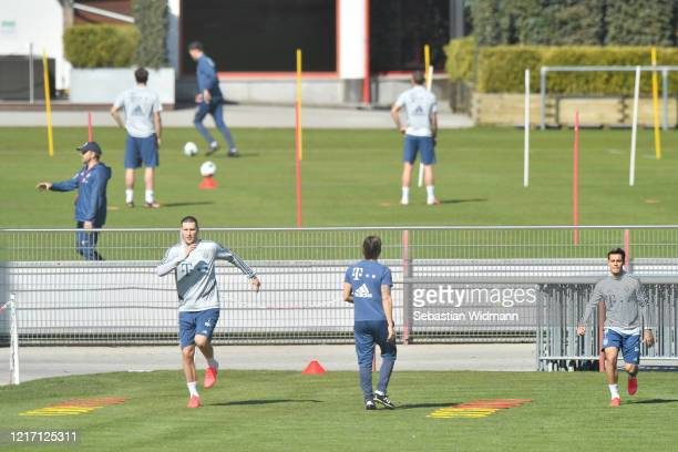 Niklas Suele and Philippe Coutinho of Bayern Muenchen run during a training session at Saebener Strasse training ground on April 06 2020 in Munich...