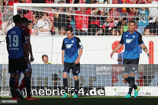 Niklas Suele and Sebastian Rudy of Hoffenheim react during the Bundesliga match between 1 FSV Mainz 05 and TSG 1899 Hoffenheim at Opel Arena on...
