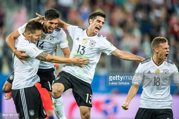 Niklas Suele Emre Can Lars Stindl and Joshua Kimmich of Germany celebrate after winning the FIFA Confederations Cup final match between Chile and...