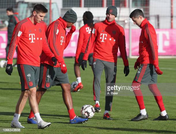 Niklas Suele Jerome Boateng Thomas Mueller and Robert Lewandowski of FC Bayern Muenchen practice during a training session at the club's Saebener...