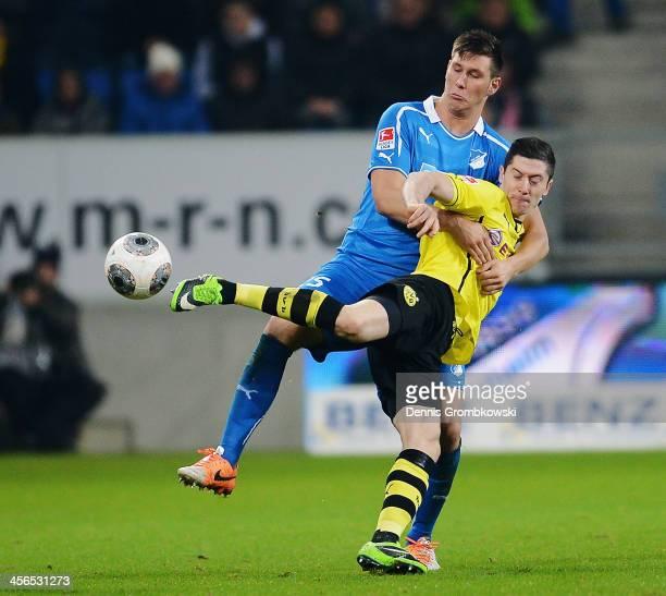 Niklas Suele of 1899 Hoffenheim challenges Robert Lewandowski of Borussia Dortmund during the Bundesliga match between 1899 Hoffenheim and Borussia...